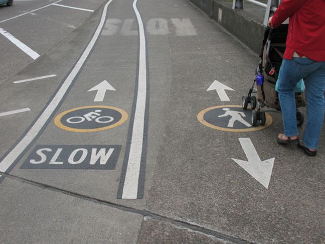 SAFER BICYCLE LANES : RAISE TO HEIGHT OF SIDEWALK